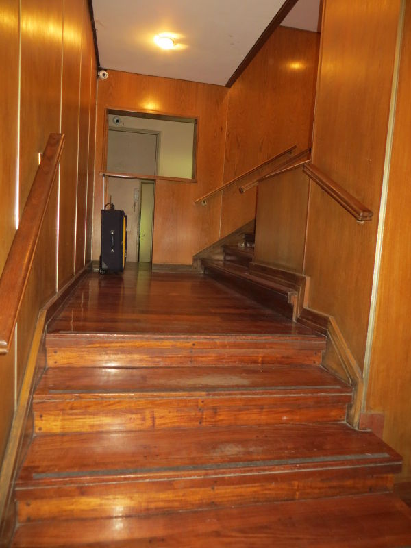 View of the two small 4 step stairs in the building entrance hall.