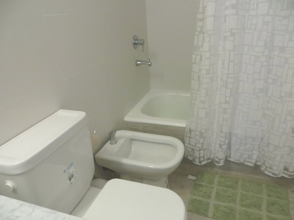 Closeup of toilet, bidet and bathtub