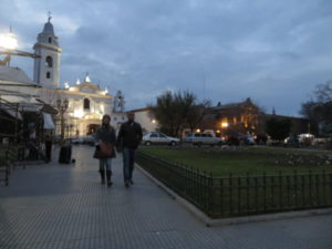 Tourists walking by night near the Pilar church recoleta