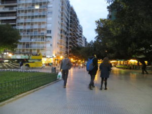 Tourists walking in front of Alvear avenue and La Biela
